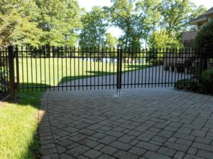 Iron Gate on a paved driveway